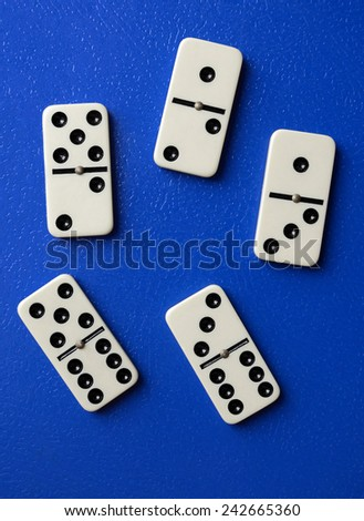 domino pieces on blue background - stock photo
