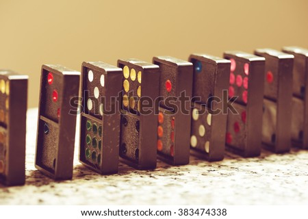 """Dominoes. Dominoes is a game played with rectangular """"domino"""" tiles. - stock photo"""