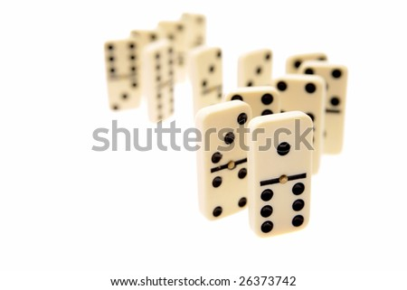 Dominoes standing on white background