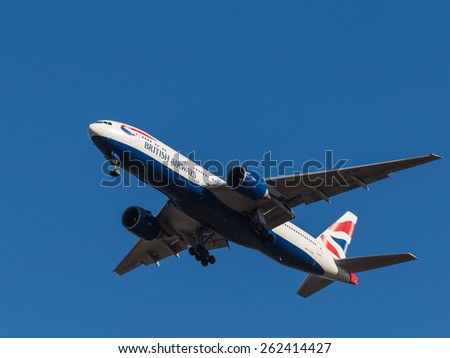 Domodedovo - March 14, 2015: A passenger plane Boeing 777, British Airways, landing at Domodedovo airport and blue sky March 14, 2015, Domodedovo, Moscow Region, Russia