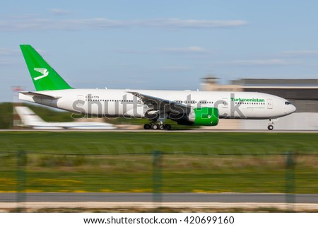 DOMODEDOVO, MOSCOW REGION, RUSSIA - MAY 14, 2016: Airplanes at Domodedovo international airport. Turkmenistan Airlines Boeing 777 takes off