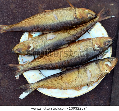 don herring golden color on a plate hot smoked fish cooked in a smokehouse