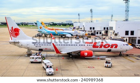 Don Mueang International Airport - air plan thai Lion air, Nok air parking on runway and prepareing to flying at Don Mueang air port on Sep19,2014 - stock photo