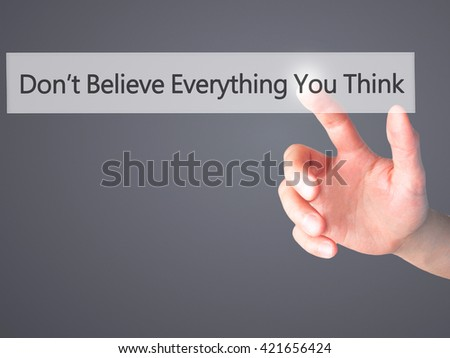 Don't Believe Everything You Think - Hand pressing a button on blurred background concept . Business, technology, internet concept. Stock Photo - stock photo