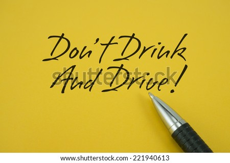 Don't Drink And Drive! note with pen on yellow background