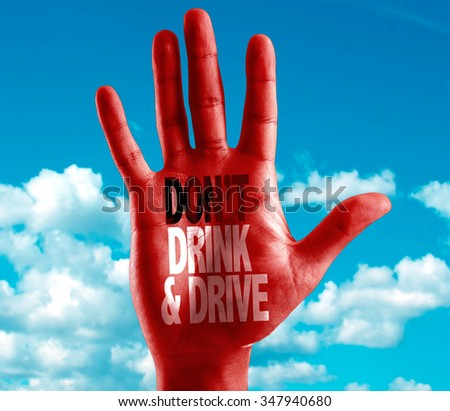 Don't Drink and Drive written on hand with sky background - stock photo