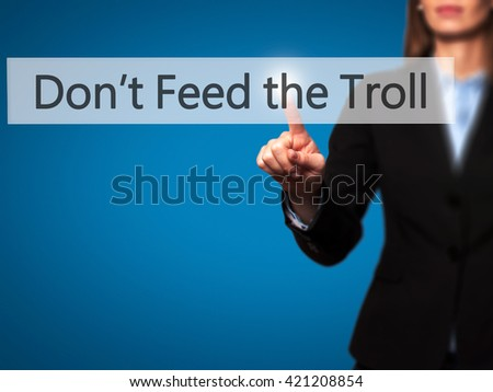Don't Feed the Troll - Businesswoman hand pressing button on touch screen interface. Business, technology, internet concept. Stock Photo - stock photo