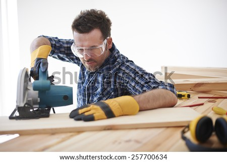 Don't forget about safety when you use electric saw - stock photo