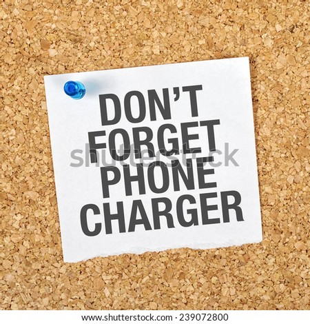 Don't Forget Phone Charger Message on Reminder Note Pinned to a Cork Memory Bulletin Board. - stock photo