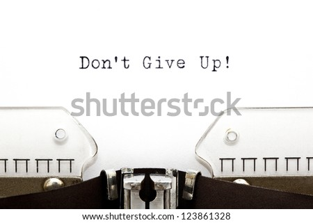 Don't Give Up printed on typewriter - stock photo