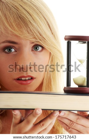 Don't have time to learn - teenager with book and hourglass