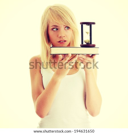 Don't have time to learn - teenager with book and hourglass - stock photo