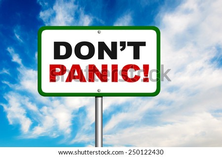 Don't panic road sign with a blue sky in a background - stock photo