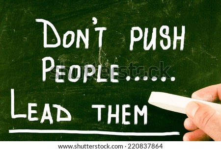 don't push people lead them - stock photo