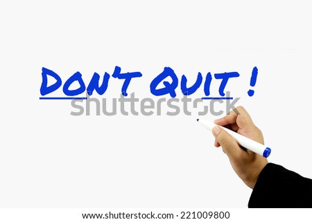 DON'T QUIT! sign on whiteboard