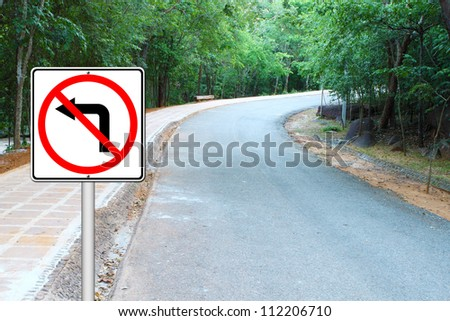don't turn left sign with a right curved road - stock photo