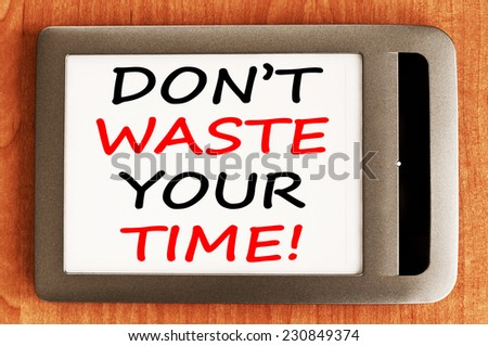 Don't Waste Your Time - Motivational concept written in e-book - stock photo