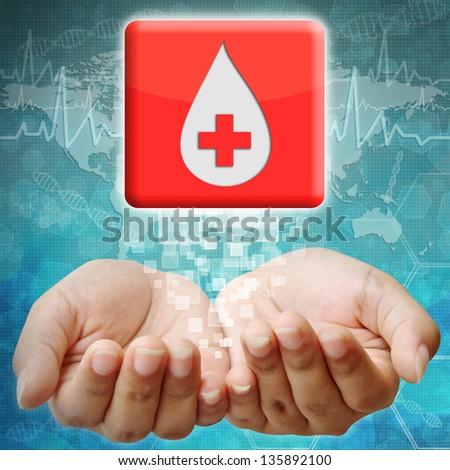 Donate blood icon on hand ,medical background - stock photo