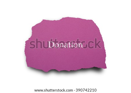 Donation word written under torn paper. - stock photo
