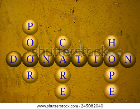 Donation written on balls infront of a wall background - stock photo