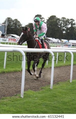 DONCASTER, ENGLAND- SEPTEMBER 11: St leger day JAMIE SPENSER on BALCARCE on SEPTEMBER 11, 2010 at doncaster race course doncaster england. the worlds oldest classic horse race - stock photo