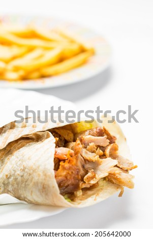 Doner kebab with fries isolated on white background. - stock photo