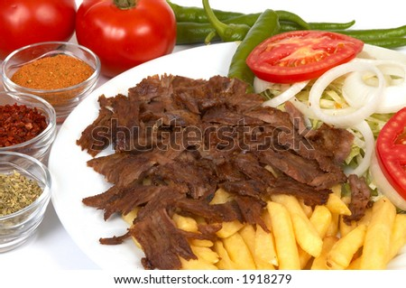 doner kebap with french fries and salads - stock photo