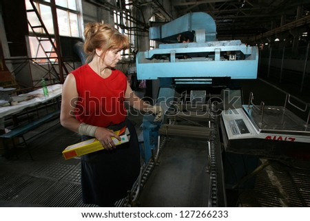 DONETSK - JULY 13: A woman working on a production line at CJSC Vistec in Donetsk, Ukraine, packs welding rods into boxes for shipping on Thursday, July 13, 2006.