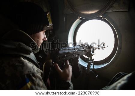 DONETSK REGION, UKRAINE - Oct 10, 2014: Ukrainian army helicopter patrols the area of of the antiterrorist operation in the Donetsk region - stock photo