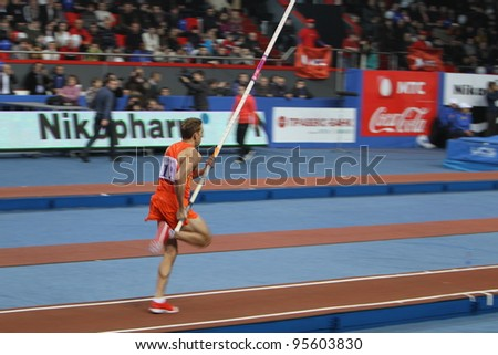 DONETSK, UKRAINE - FEB.11: Dilla Karsten competes in the Samsung Pole Vault Stars meeting on February 11, 2012 in Donetsk, Ukraine. He won bronze medal at 2008 in the World Junior Championships. - stock photo