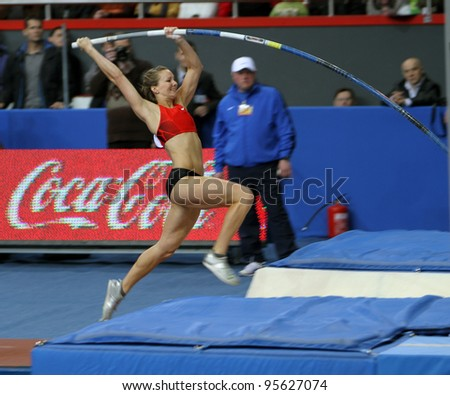 DONETSK,UKRAINE-FEB.11: Hutson Kylie - american pole vaulter compete in the pole vault competition with the result 4.50 on Samsung Pole Vault Stars meeting on February 11, 2012 in Donetsk, Ukraine. - stock photo