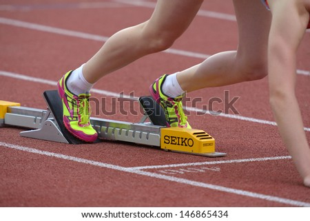 DONETSK, UKRAINE - JULY 13: Athlete prepares to the start in 400 meters hurdles during 8th IAAF World Youth Championships in Donetsk, Ukraine on July 13, 2013 - stock photo