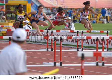 DONETSK, UKRAINE - JULY 11: Girls compete in semi-final of 100 m hurdles during 8th IAAF World Youth Championships in Donetsk, Ukraine on July 11, 2013