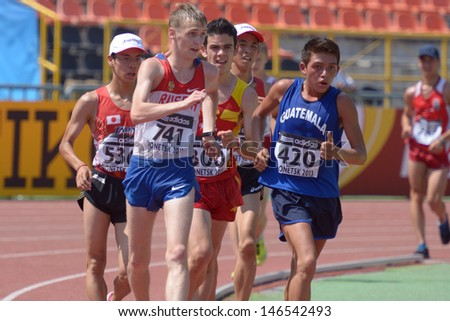 DONETSK, UKRAINE - JULY 13: Leading group of competitors in the final of 10,000 meters Race Walk during World Youth Championships in Donetsk, Ukraine on July 13, 2013