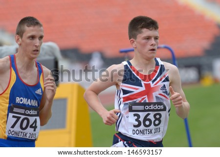 DONETSK, UKRAINE - JULY 11: Liam Dee of Great Britain (right) and Ionut Dragusin of Romania compete in the heat on 1500 m during 8th IAAF World Youth Championships in Donetsk, Ukraine on July 11, 2013