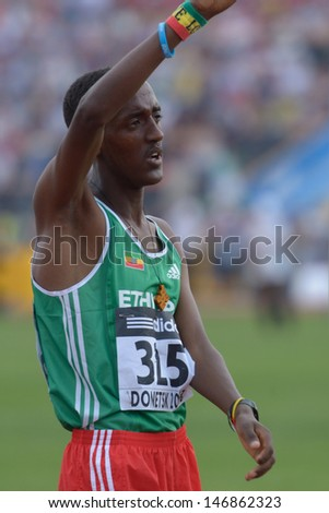 DONETSK, UKRAINE - JULY 14: Mogos Tuemay of Ethiopia after finish in the final heat on 3000 metres during 8th IAAF World Youth Championships in Donetsk, Ukraine on July 14, 2013