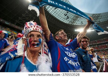 "DONETSK, UKRAINE - JUNE 15: France national football team supporters show their support during UEFA EURO 2012 on ""DONBAS ARENA"" soccer stadium in Donetsk on June 15, 2012 in Donetsk, Ukraine. - stock photo"