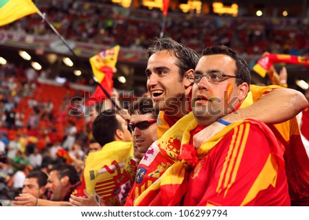 DONETSK, UKRAINE - 27 JUNE 2012: Spanish football fans support their national team on the semifinal match Spain - Portugal. Donetsk, Donbass Arena. EURO 2012 in Ukraine, 27 june 2012 - stock photo