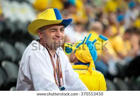 "DONETSK, UKRAINE - JUNE 15: Ukraine national football team supporters show their support during UEFA EURO 2012 on ""DONBAS ARENA"" soccer stadium in Donetsk on June 15, 2012 in Donetsk, Ukraine. - stock photo"