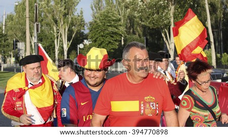 DONETSK, UKRAINE - JUNE 27, 2012: Unidentified Spanish soccer fans before UEFA EURO 2012 match in Donetsk near Donbass Arena - stock photo