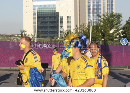 DONETSK, UKRAINE - JUNE 19, 2012: Unidentified Ukrainian soccer fans before UEFA EURO 2012 match in Donetsk on Donbass Arena - stock photo
