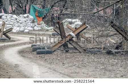 DONETSK, UKRAINE - March 4, 2015: Checkpoint pro-Russian separatists in the area Putilovskaya Roshcha, Donetsk. -- This area is adjacent to the Donetsk airport named after Sergei Prokofiev.  - stock photo