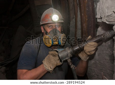 Donetsk, Ukraine - March, 14, 2014: Miner working underground in the mine named after Abakumov - stock photo