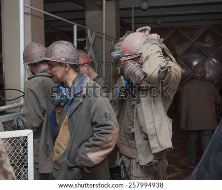Donetsk, Ukraine - March, 25, 2013: Miners mine named after Abakumov receive personal protective equipment to work shift - stock photo