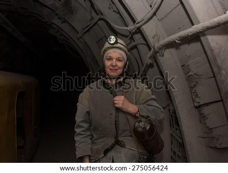 Donetsk, Ukraine - March, 14, 2014: Woman surveyor in the underground mine. Mine is named Abakumov - stock photo