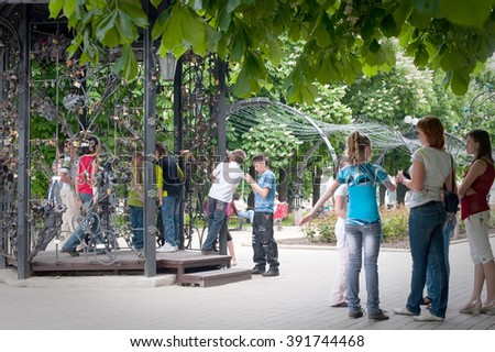 DONETSK, UKRAINE - May, 26, 2011 -  children playing in the park of  forged figures in Donetsk