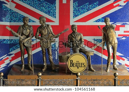 DONETSK, UKRAINE - MAY 29: Monument to The Beatles on May 29, 2012 in Donetsk, Ukraine. Monument was installed in 2006 and this is the first monument to The Beatles in the former USSR. - stock photo