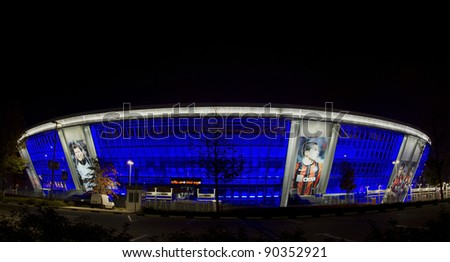 "DONETSK, UKRAINE - OCTOBER 15 - ""DONBAS ARENA"" soccer stadium in Donetsk by night. The stadium will host matches of UEFA Euro 2012. Donetsk, October 15, 2011. - stock photo"