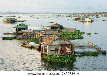 DONG NAI, VIET NAM- FEB 28: Life of Asian fisherman on La Nga river, group of floating house in residence of fishing village, people make living by aquaculture, river fish, Vietnam, Feb 28, 2015