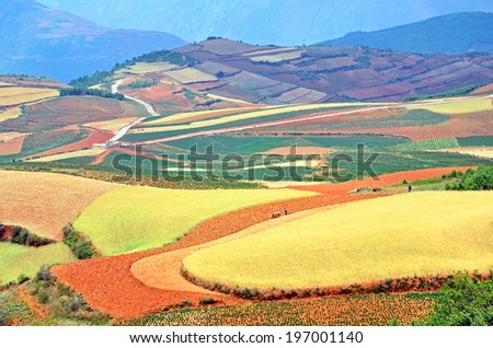 DONGCHUAN, CHINA � MAY 28, 2014: Dongchuan Red Land is located in Yunnan Province, China with an altitude of 1800-2600 meters above sea level and it is famous for its red soil and colorful farms. - stock photo